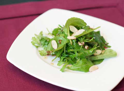 Mixed Greens Salad with Pomegranates and Marconi Almonds